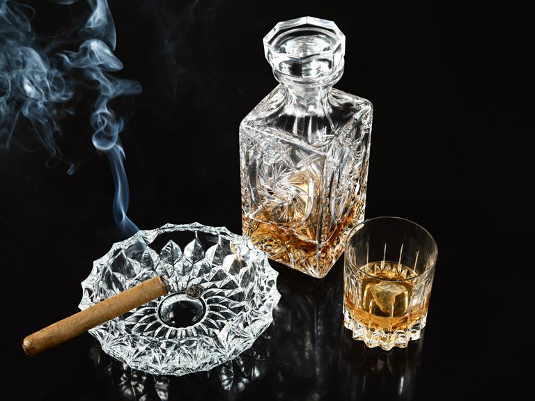 Cigar in Ashtray With Decanter and Tumbler of Whiskey
