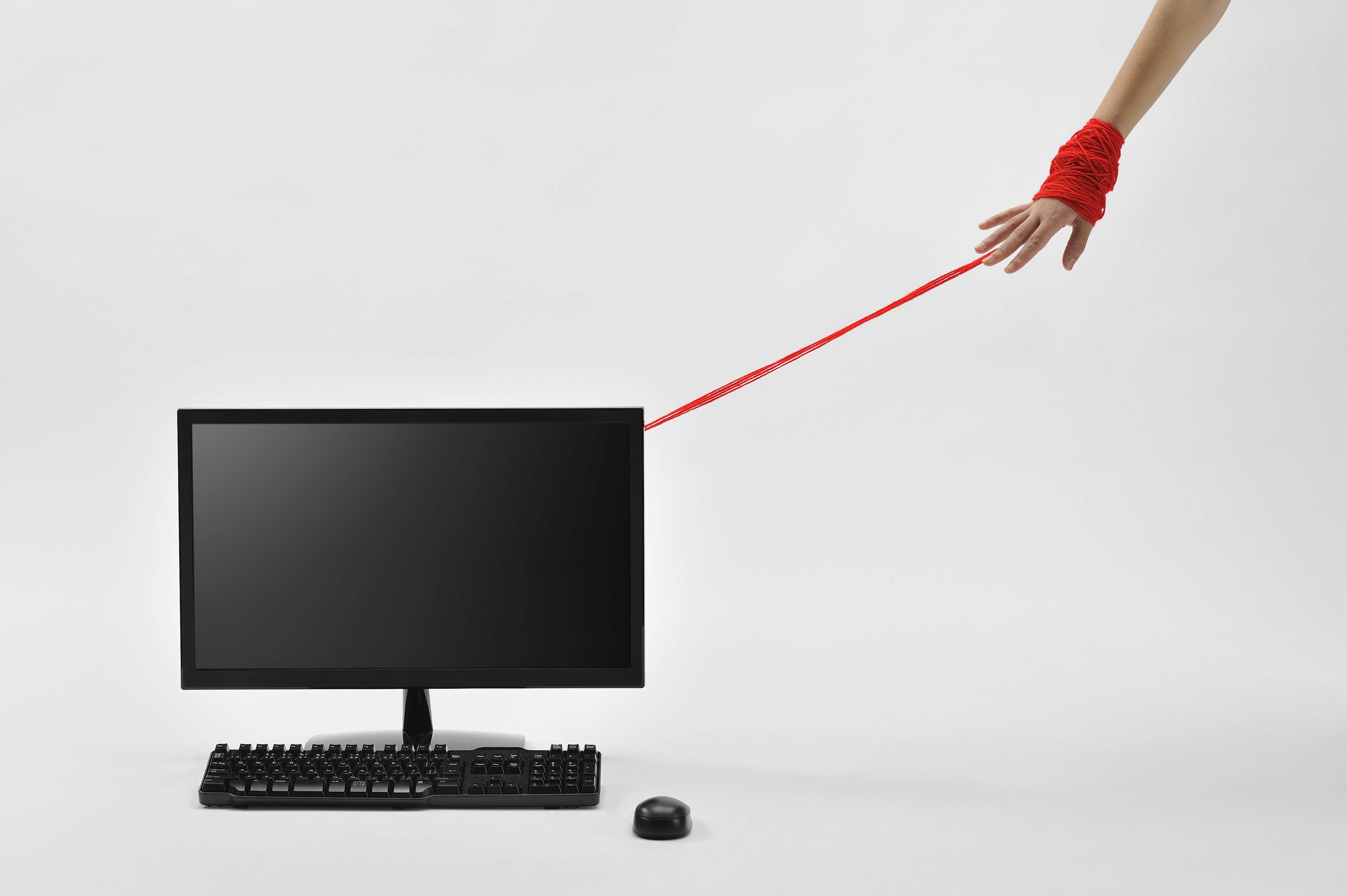Hand tied to a computer