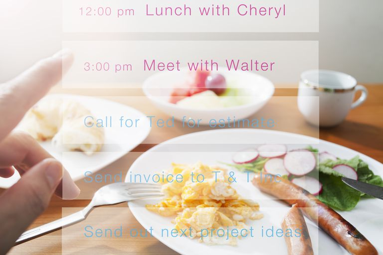 a day planner overlaid over a table with a meal on it