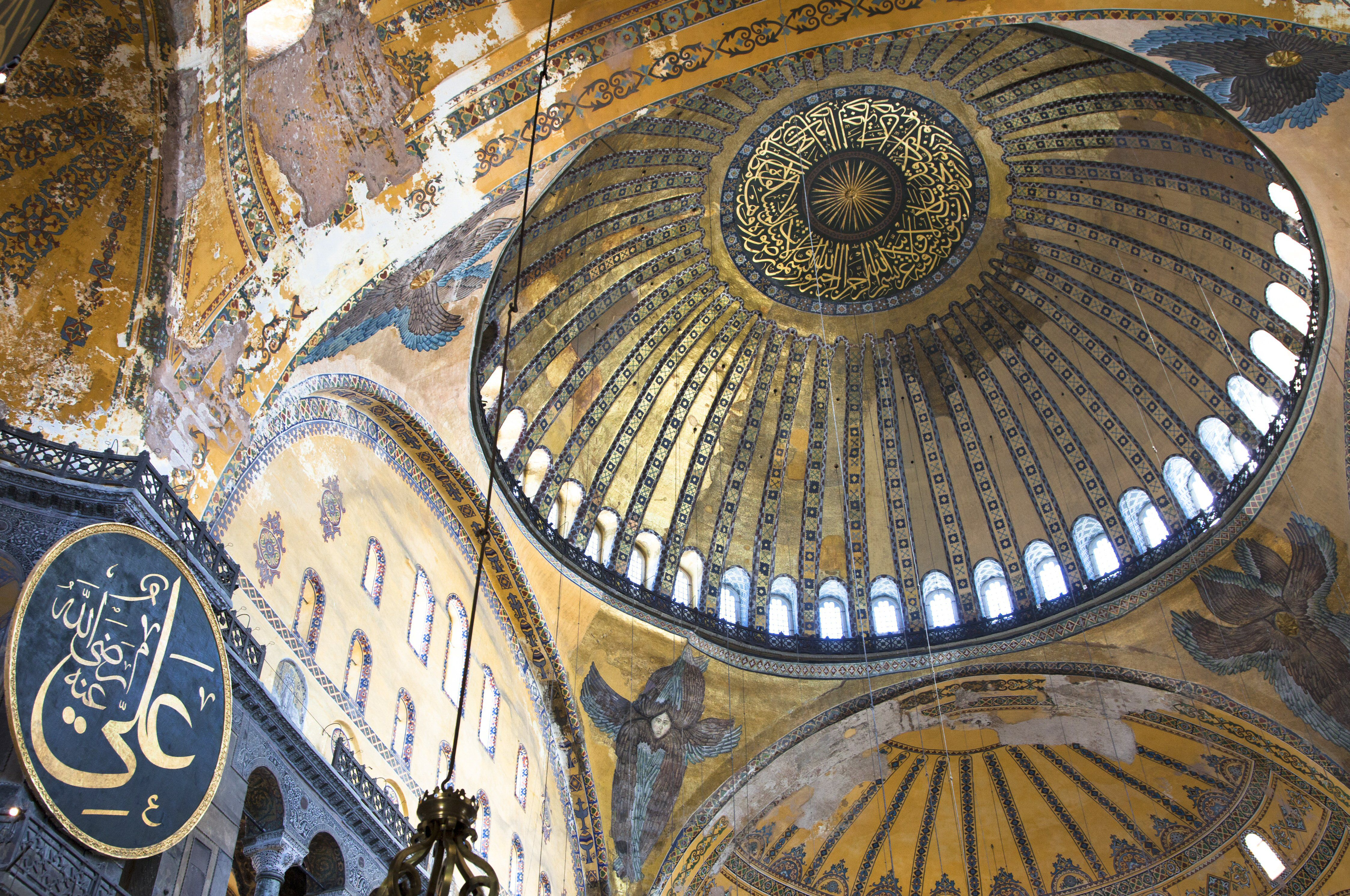 Interior domes, large, decorated, windows around the bottom, dominant colors are gold and blue