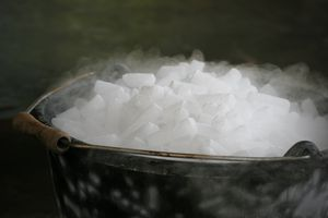 Bucket of dry ice pellets going through sublimation