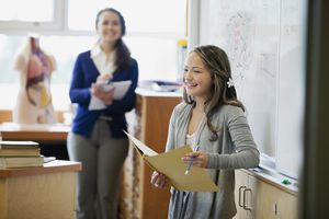 female, middle school student giving presentation