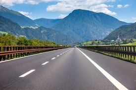 A highway stretches into a mountain landscape.