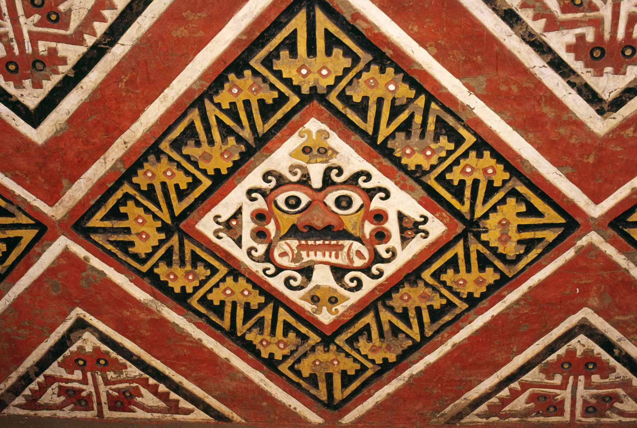 Polychrome frieze representing the face of the Moche god Aipaec