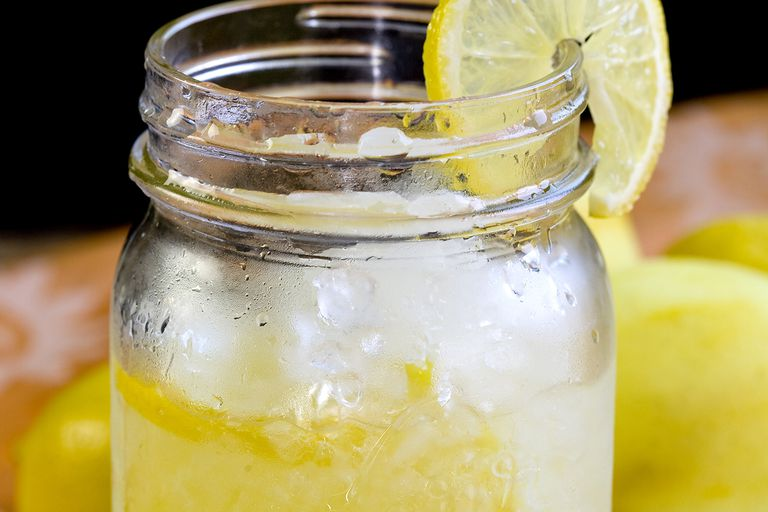 Close up of Lemonade with lemon on it