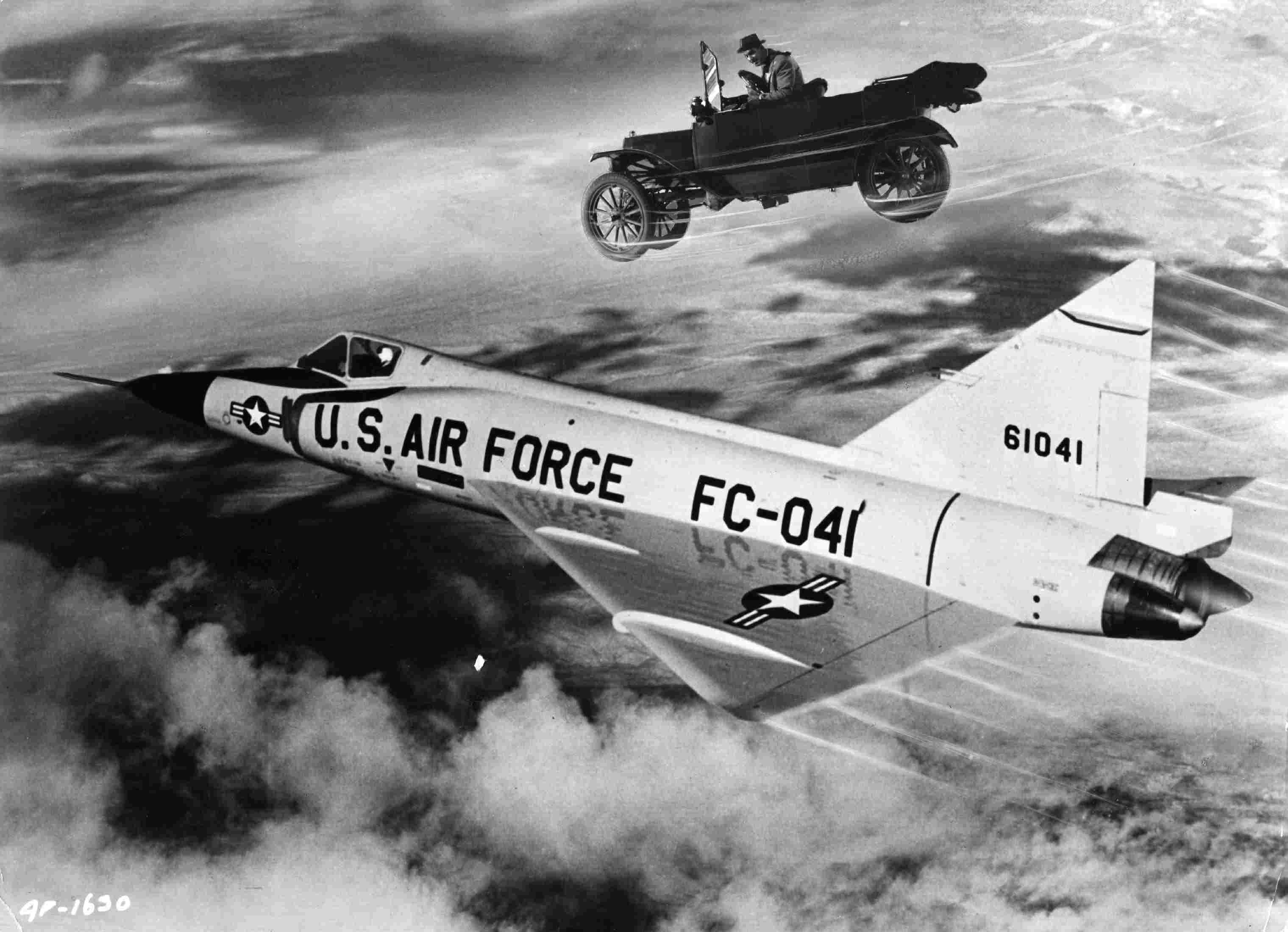 Flying Jalopy above an Air Force jet