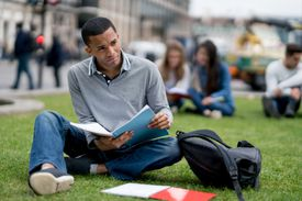 African American student studying outdoors in London