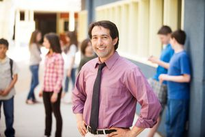 male teacher smiling