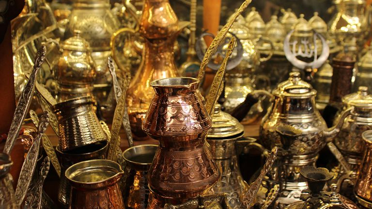 Assortment of shiny metallic objects such as lamps and goblets.
