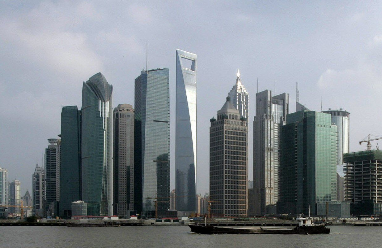 The Shanghai World Financial Centre is a soaring glass skyscraper with a distinctive opening at the top
