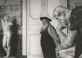 Photograph of Auguste Rodin, pictured with some of his sculptures