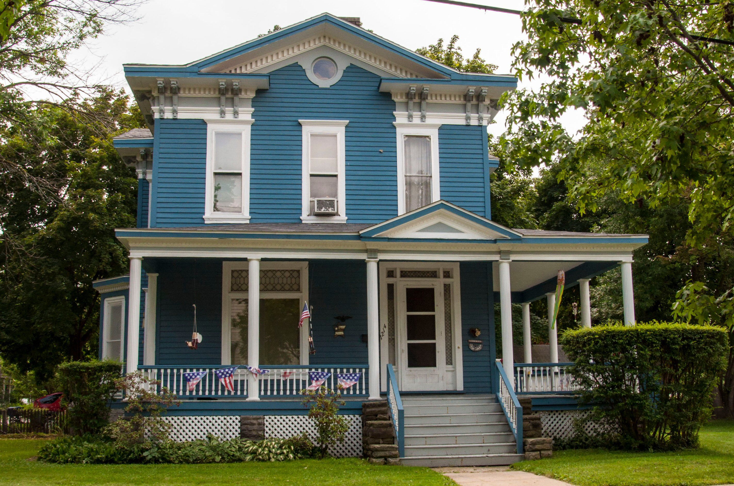 Two Story Victorian House Blue With White Trim Wrap Around Porch