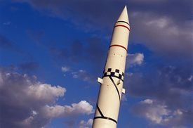 Redstone nuclear rocket, low angle view, against a blue sky.