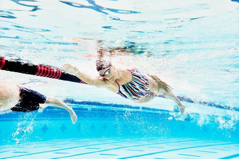 Underwater shot of woman swimming in lane of pool