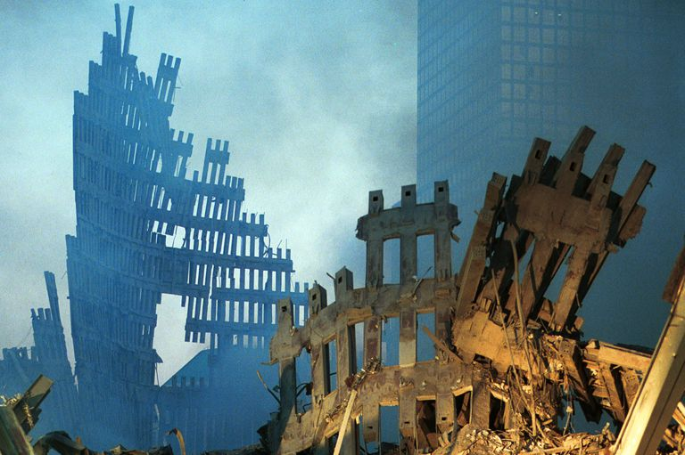 smoldering framework of fallen twin towers