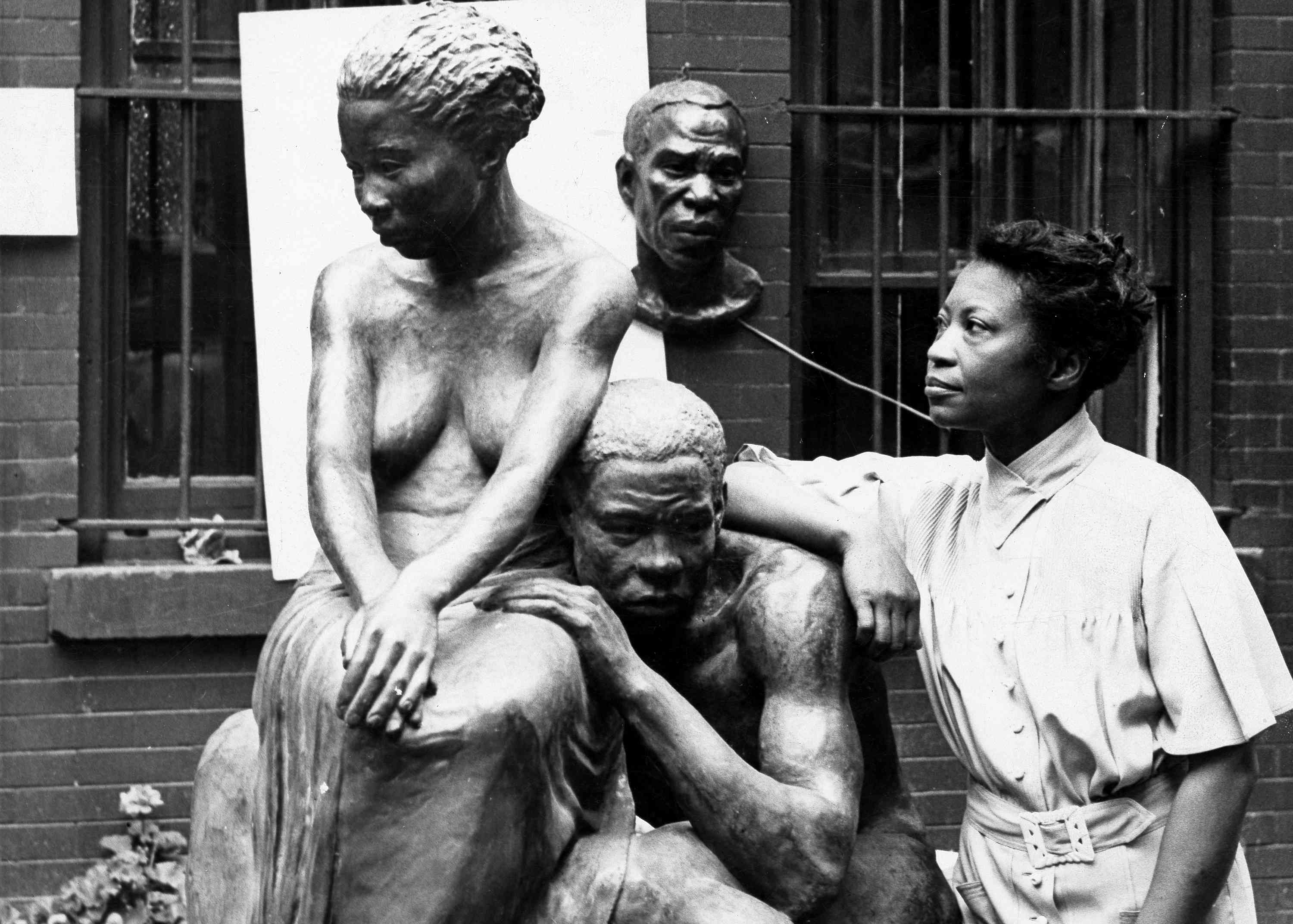 Augusta Savage poses with her sculpture Realization