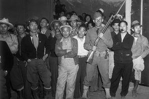 Japanese Internees Under Guard, ca. 1944
