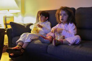 Children watching horror movie.