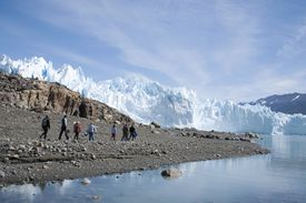 Tourists visiting a glacier in Argentina