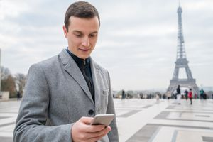 Frenchman checking email on phone