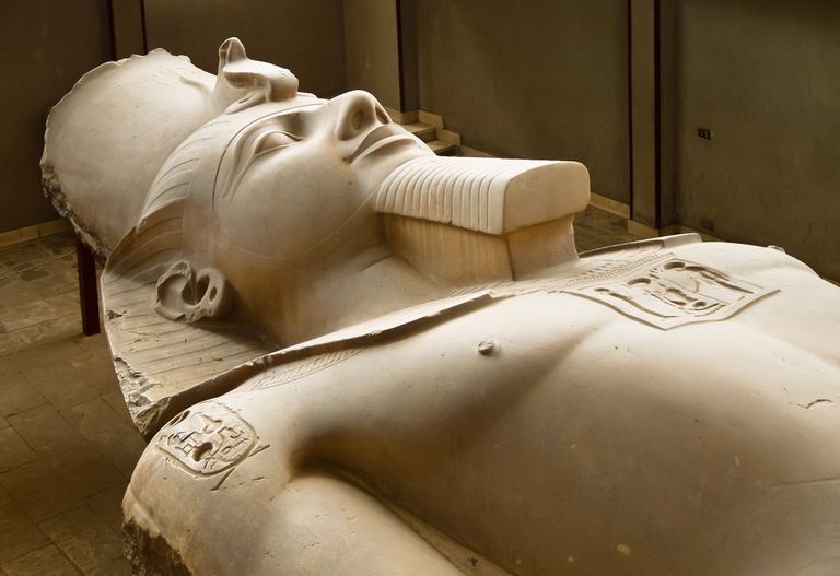 A limestone statue of Ramses II, lying on display