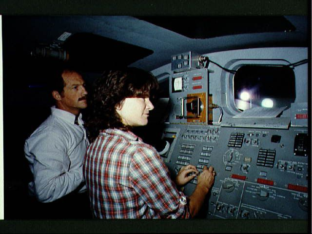 Sally Ride and Frederick Hauck go over procedures with the RMS.