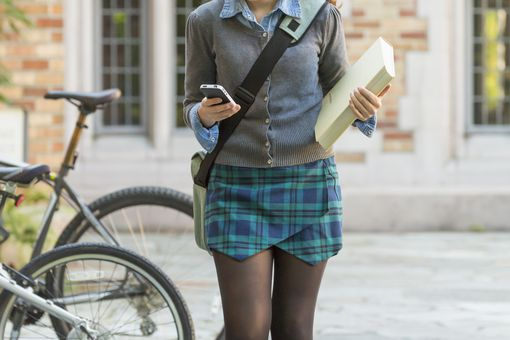University student with cell phone on campus