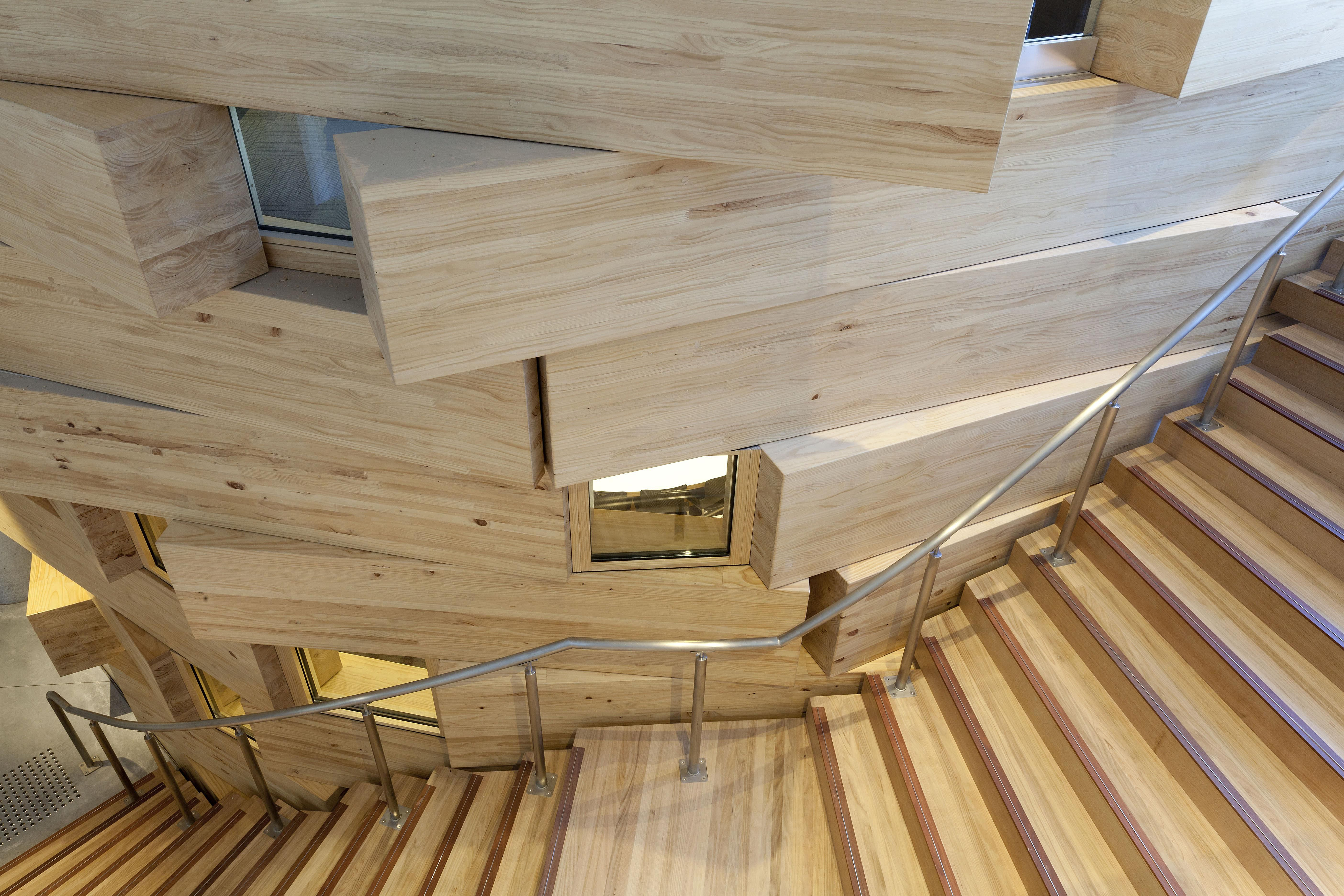 Curved wooden stairs, offset block wood walls, inset square windows, Gehry, UTS, Sydney
