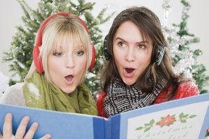 Women singing Christmas carols caroling