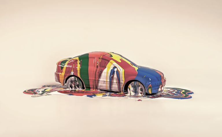 A car covered in colorful paint