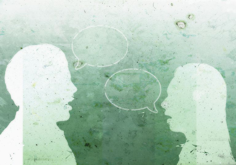 A man with an empty speech bubble facing a woman with an empty speech bubble