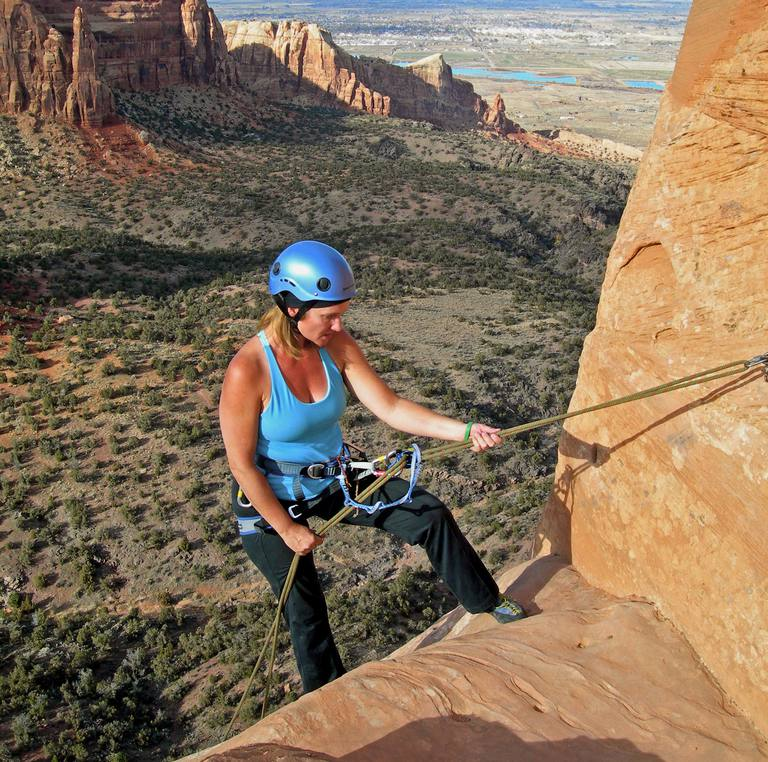 Susan Joy Paul rappels off Independence Monument at Colorado National Monument.
