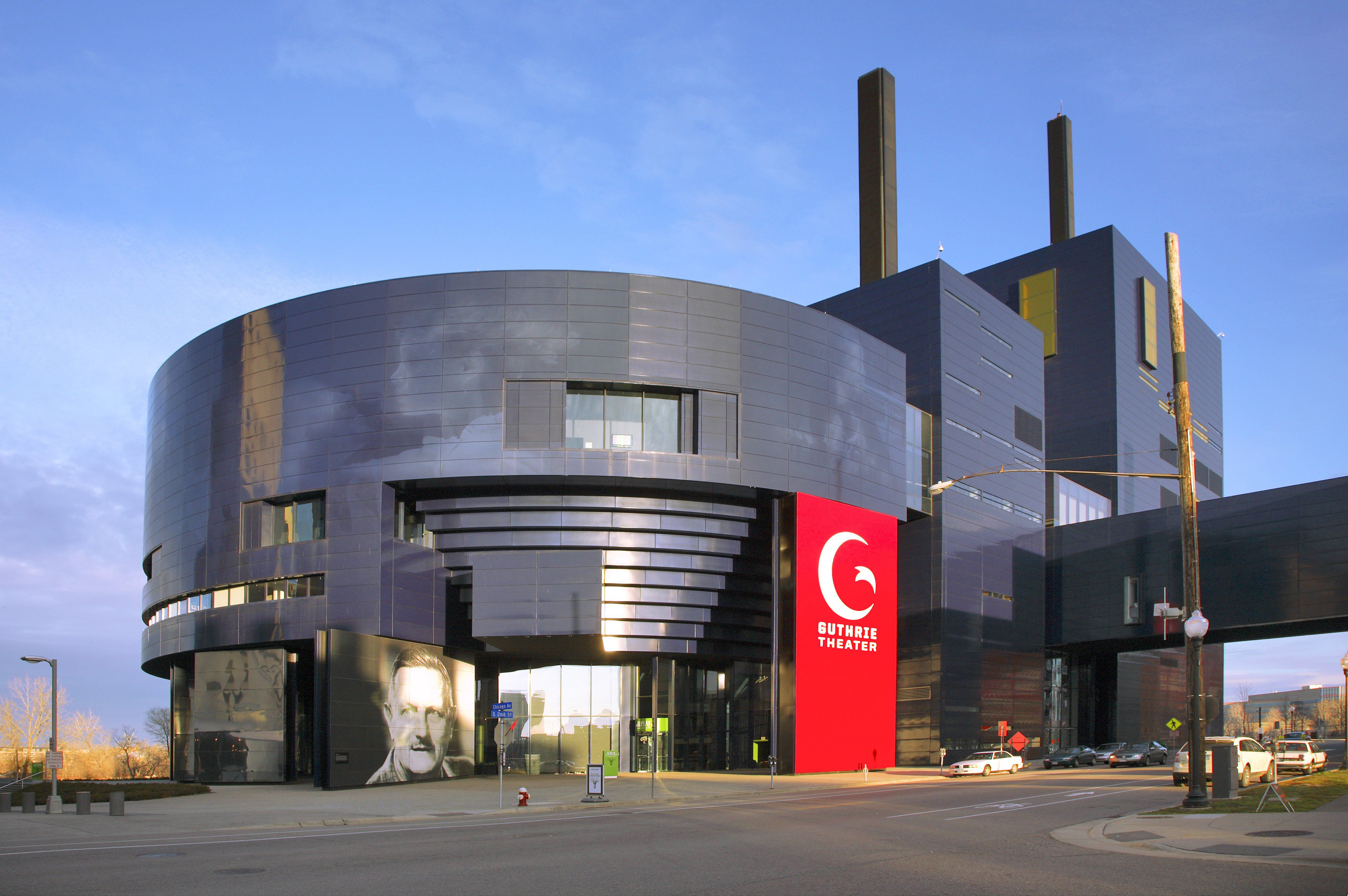grey-blue roundish shaped industrial-looking building