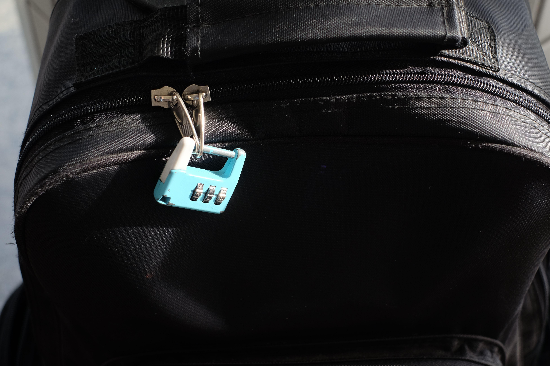 old blue key lock zip of black bag