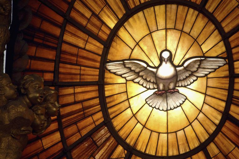 The seven gifts of the holy spirit and what they mean holy spirit stained glass window negle Images