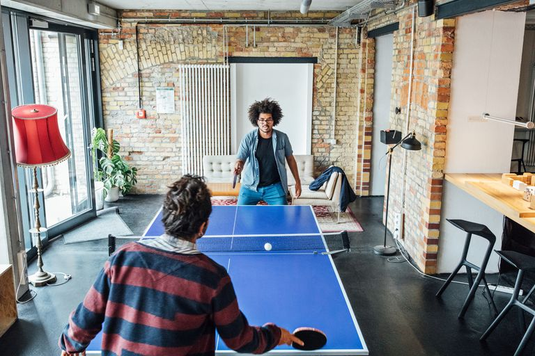 Businessmen playing table tennis