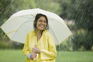 Woman under an umbrella enjoying the rain