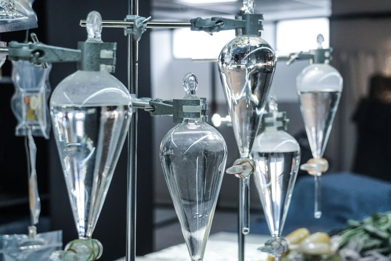 Distilling flasks filled with water in a laboratory