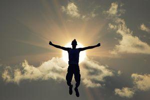 Teenager jumping in sun