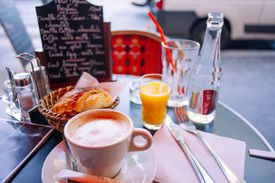 Breakfast served on a table in a French cafe