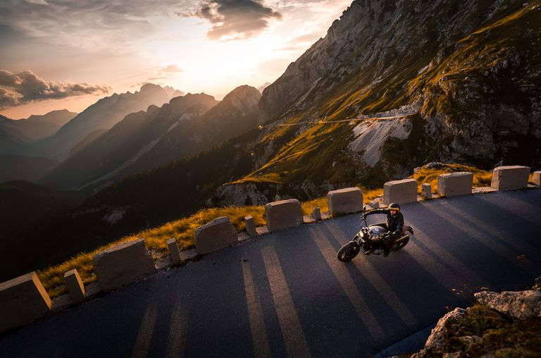 Man riding motorcycle on mountain road