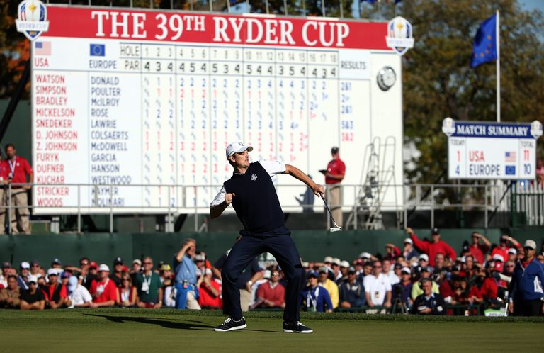 Justin Rose of Europe celebrates a birdie putt on the 18th green to defeat Phil Mickelson 1up during the Singles Matches for The 39th Ryder Cup at Medinah Country Club on September 30, 2012