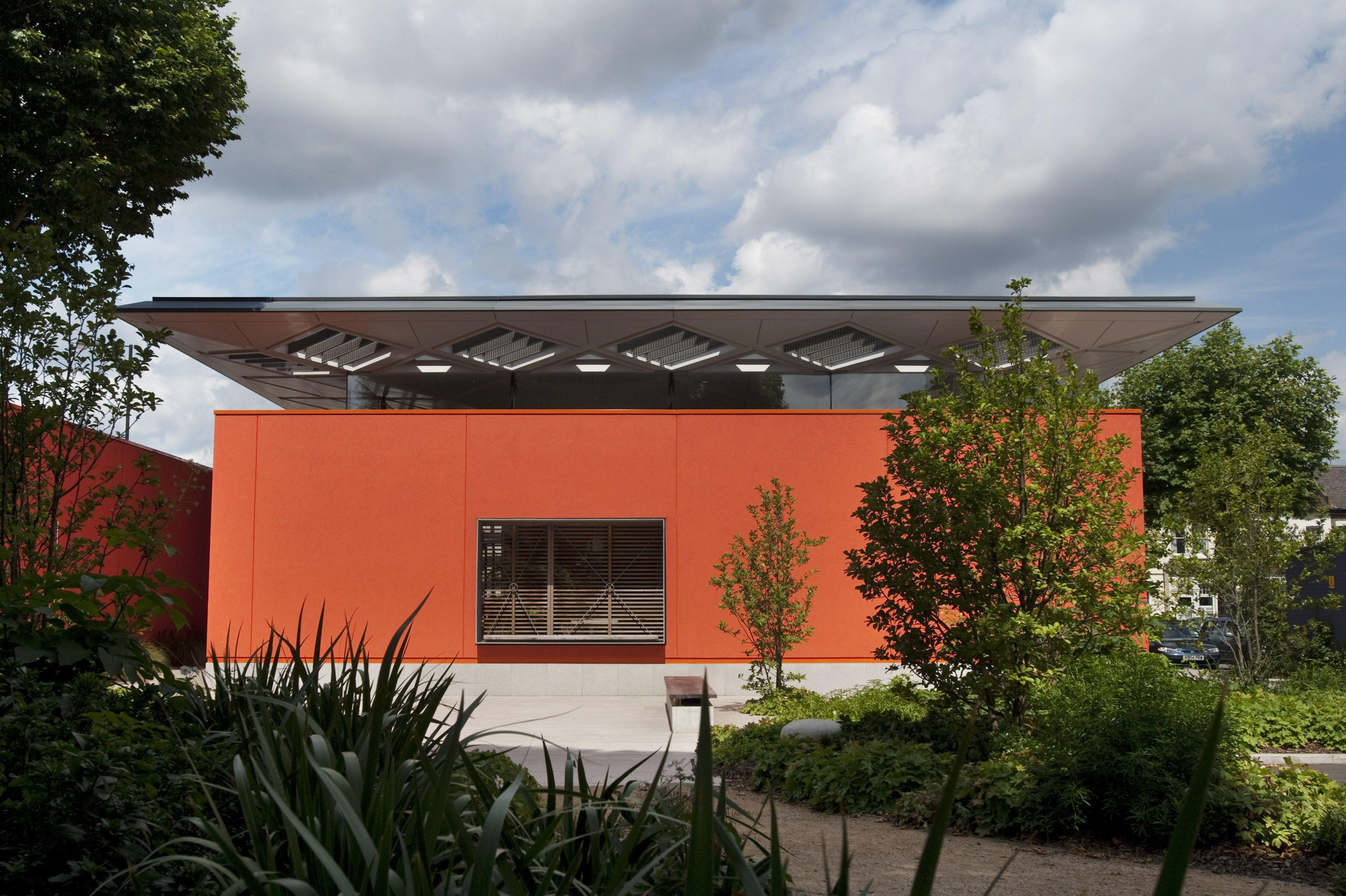 simple rectangular building facade, no windows, front door, curved roof