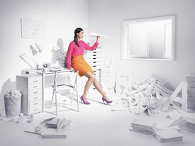 Woman in an office with letters.