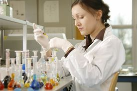 woman working in lab with test tubes