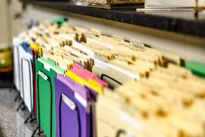 Close-Up Of Colorful Files For Sale In Store