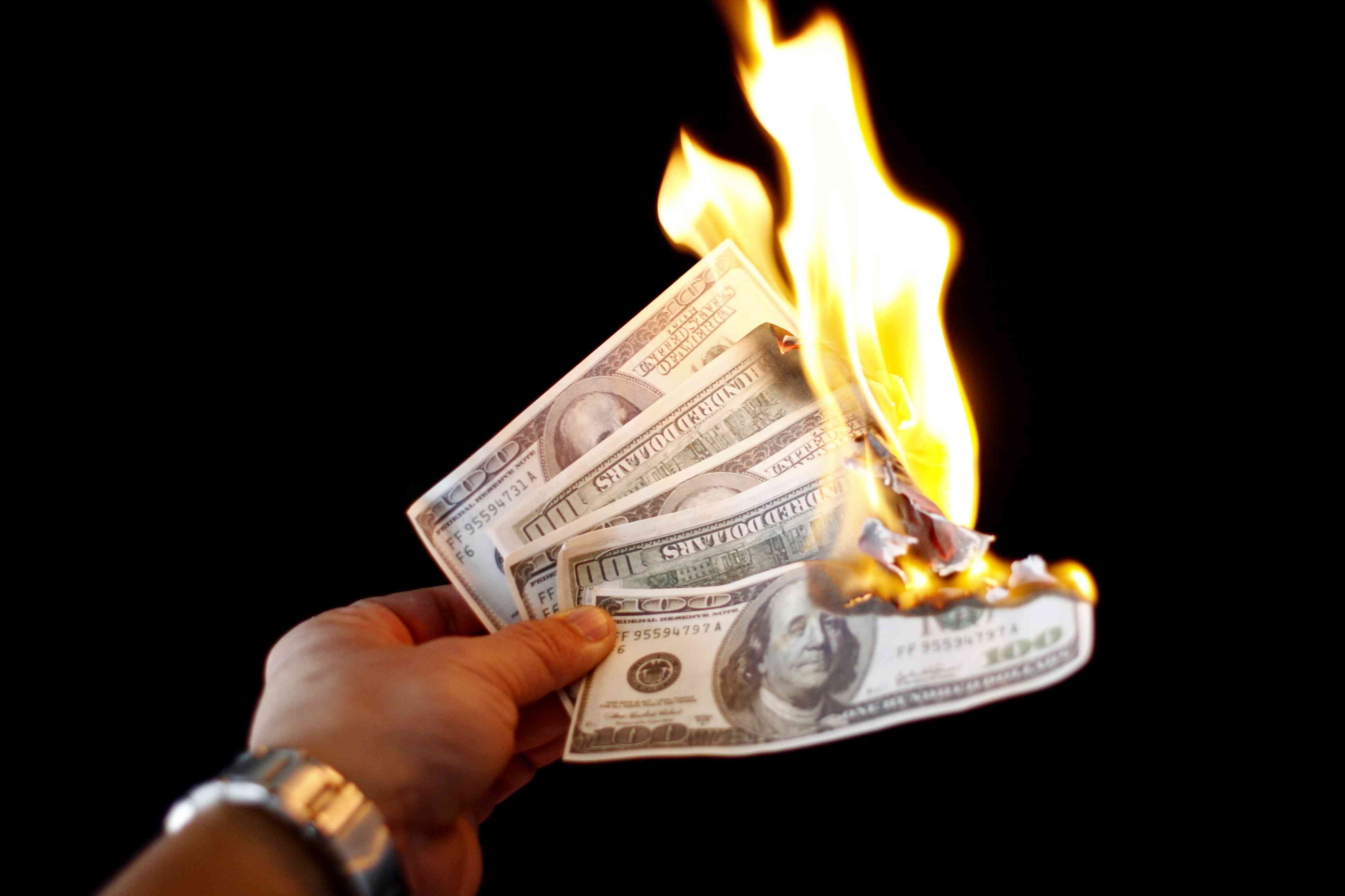 Burning money trick