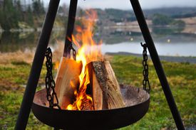 Portable fireplace by the lake