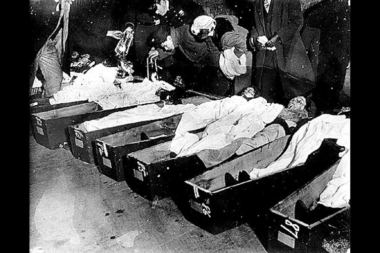 Identifying bodies at the morgue, after the Triangle Shirtwaist Factory Fire.