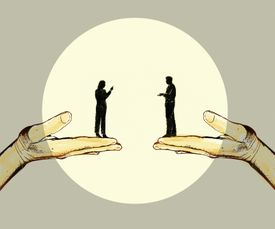 Silhouettes of a man and a woman standing in large hands and having a discussion